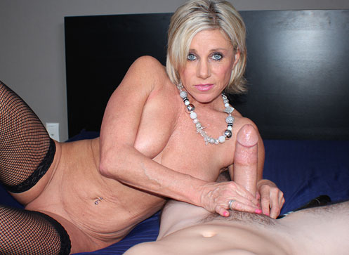 Naughty blonde MILF work her magical hands all over a thick cock