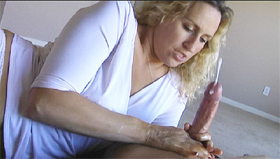 "Amateur Milf Joey Lynn face lights up at as she jerks a fat cock until buckets of cum spurts out all over her hands! ""Do you feel better now"" Joey Lynn says her pink pussy gets wet at the sight of large cum blasts! Fuck yeah my kinda chick!"