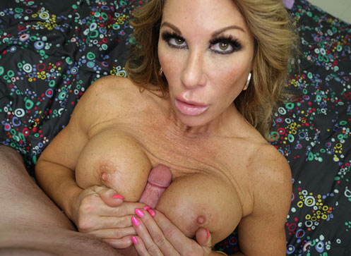 Horny milf Farrah stripes down naked and jerks off the young boy
